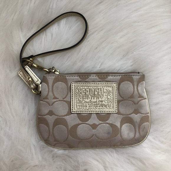 Coach Handbags - Gently Used Gold Coach Wristlet